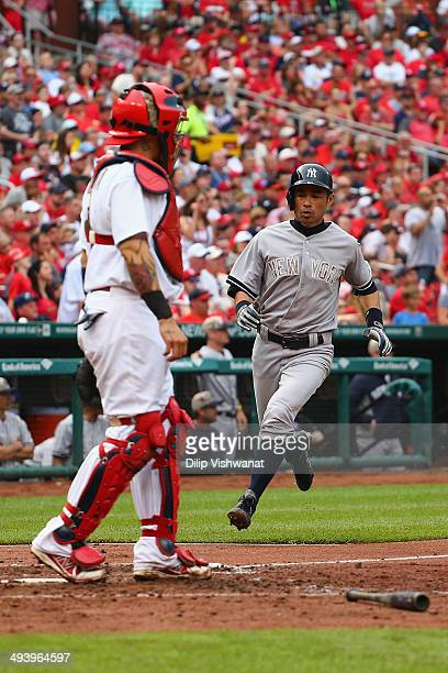 Ichiro Suzuki of the New York Yankees scores a run against the St Louis Cardinals in the fifth inning at Busch Stadium on May 26 2014 in St Louis...
