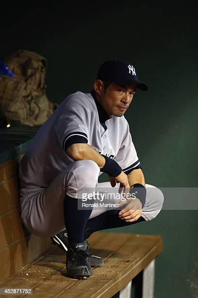 Ichiro Suzuki of the New York Yankees sits in the dugout against the Texas Rangers in the seventh inning at Globe Life Park in Arlington on July 28,...