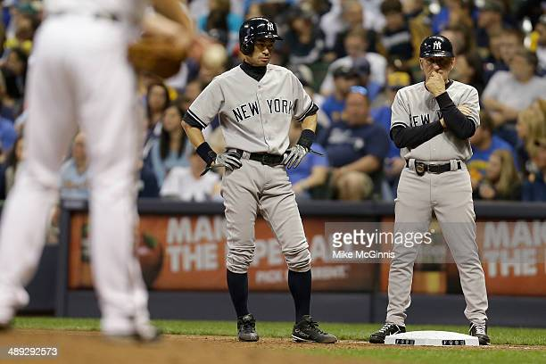 Ichiro Suzuki of the New York Yankees stands at first base after hitting a single in the seventh inning against the Milwaukee Brewers during the...