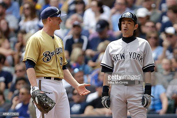 Ichiro Suzuki of the New York Yankees stands at first base after drawing a walk during the top of the first inning against the Milwaukee Brewers...