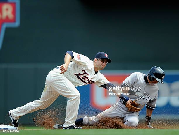Ichiro Suzuki of the New York Yankees steals second base as Brian Dozier of the Minnesota Twins fields the ball during the fifth inning of the game...
