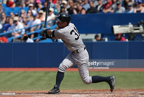 Ichiro Suzuki of the New York Yankees strikes out in the fifth inning during MLB game action against the Toronto Blue Jays on August 30, 2014 at...