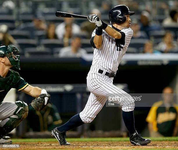Ichiro Suzuki of the New York Yankees takes his turn at bat in the eighth inning as John Jaso of the Oakland Athletics defends on June 3 2014 at...