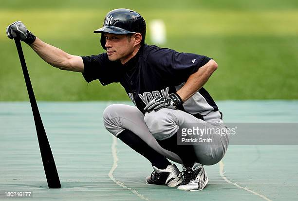 Ichiro Suzuki of the New York Yankees waits to bat during batting practice before playing against the Baltimore Orioles at Oriole Park at Camden...