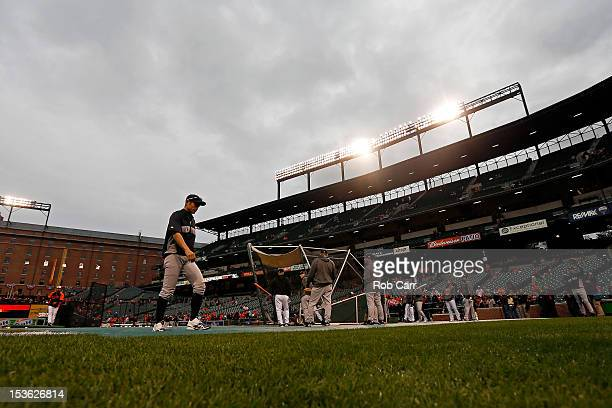Ichiro Suzuki of the New York Yankees walks across the field during batting practice against the Baltimore Orioles during Game One of the American...