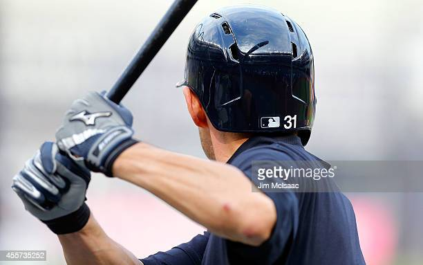 Ichiro Suzuki of the New York Yankees warms up during batting practice before a game against the Tampa Bay Rays at Yankee Stadium on September 10...