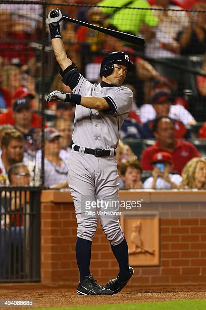 Ichiro Suzuki of the New York Yankees warms up while waiting to pinch hit against the St Louis Cardinals in the seventh inning at Busch Stadium on...