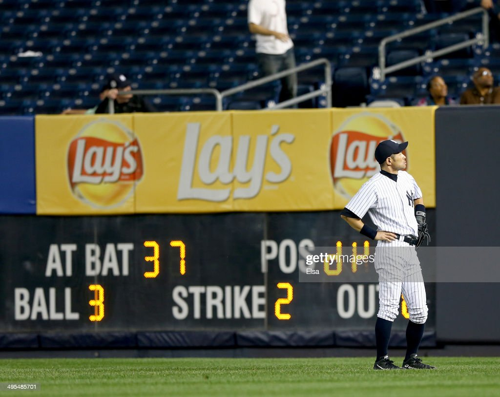 Ichiro Suzuki #31 of the New York Yankees watches as a hit by Brandon Moss #37 of the Oakland Athletics heads into the stands after Moss hit a solo home run in the 10th inning on June 3, 2014 at Yankee Stadium in the Bronx borough of New York City.