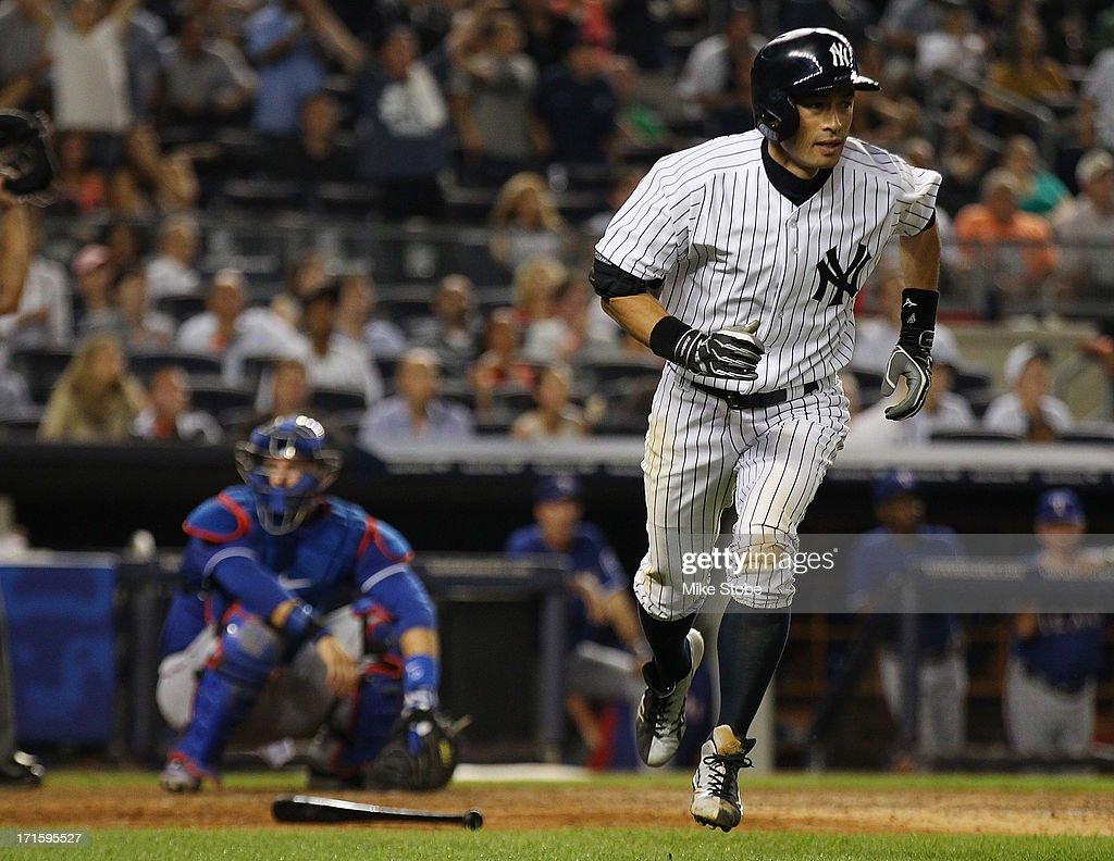 Ichiro Suzuki #31 of the New York Yankees watches his two run home run in the seventh inning against the Texas Rangers at Yankee Stadium on June 26, 2013 in the Bronx borough of New York City.