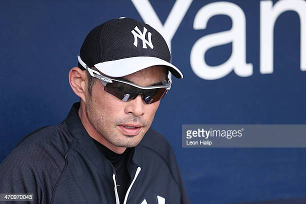 Ichiro Suzuki of the New York Yankees watches the action from the dugout during spring training at George M Steinbrenner Field on February 21 2014 in...