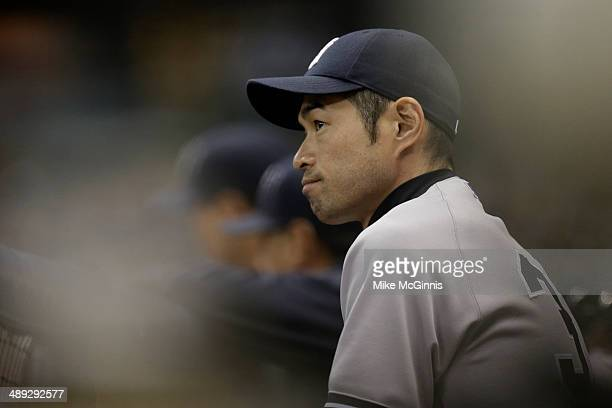 Ichiro Suzuki of the New York Yankees watches the game from the dugout during the bottom of the sixth inning against the Milwaukee Brewers in the...