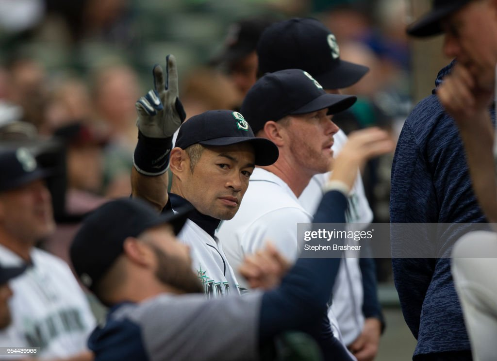 Ichiro Suzuki #51 of the Seattle Mariner acknowledges fans from the dugout before a game against the Oakland Athletics at Safeco Field on May 3, 2018 in Seattle, Washington. The Mariners announced before the game that Ichiro would transition out of a playing role for 2018 and into the front office as a special assistant to the chairman, effective today. Ichiro's agent said that the 10-time All-Star is not retiring, leaving open the possibility of returning to the field in 2019, according to published reports.