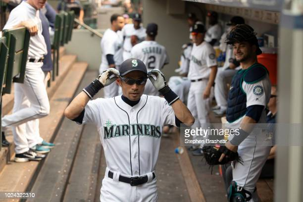 Ichiro Suzuki of the Seattle Mariners adjusts his sunglasses as he walks through the dugout before a game against the Houston Astros at Safeco Field...