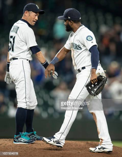 Ichiro Suzuki of the Seattle Mariners an dDenard Span of the Seattle Mariners celebrate after a game against the Baltimore Orioles at Safeco Field on...