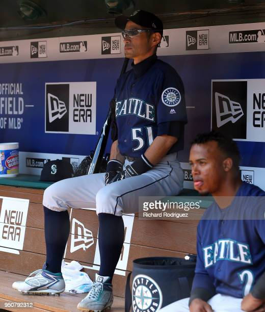 Ichiro Suzuki of the Seattle Mariners and Jean Segura of the Seattle Mariners sit in the dugout during a baseball game against the Texas Rangers at...