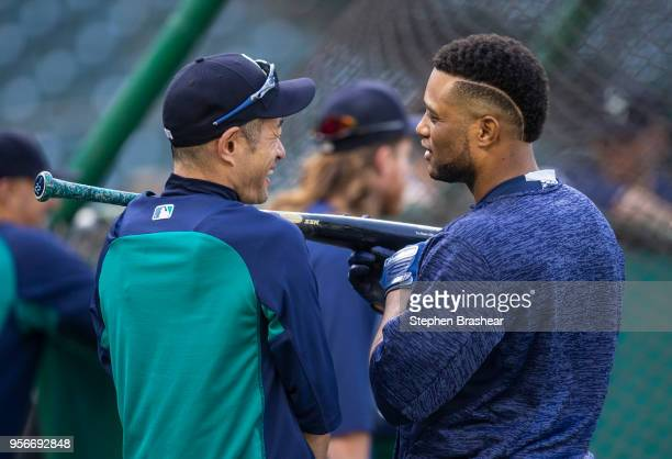Ichiro Suzuki of the Seattle Mariners and Robinson Cano of the Seattle Mariners talk during batting practice before a game before a game against the...