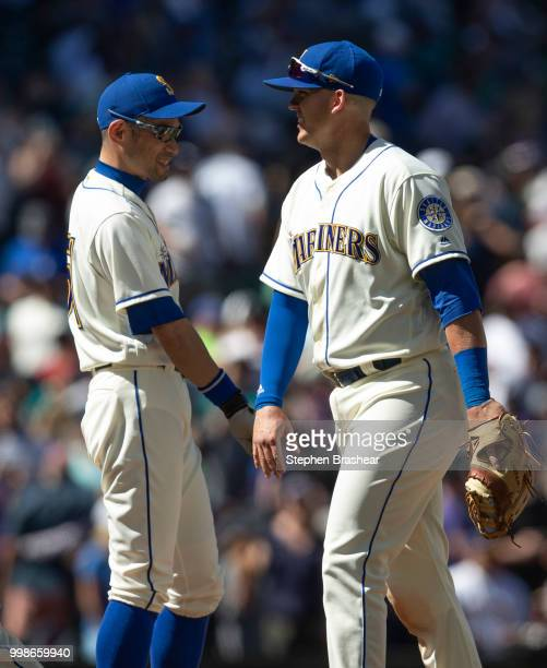 Ichiro Suzuki of the Seattle Mariners and Ryon Healy of the Seattle Mariners celebrate after a game against the Colorado Rockies at Safeco Field on...