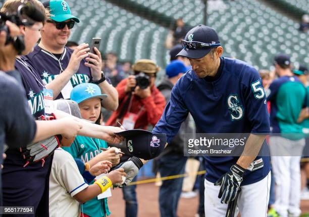 Ichiro Suzuki of the Seattle Mariners autographs balls for fans before a game against the Los Angeles Angels of Anaheim at Safeco Field on May 5 2018...