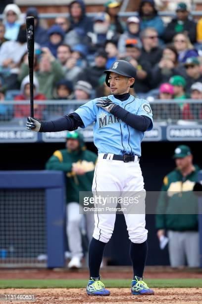 Ichiro Suzuki of the Seattle Mariners bats against the Oakland Athletics during the third inning of the MLB spring training game at Peoria Stadium on...