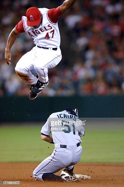 Ichiro Suzuki of the Seattle Mariners beats a high throw to Howie Kendrick of the Los Angeles Angels for a stolen base in the fifth inning at Angel...