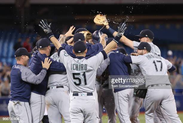 Ichiro Suzuki of the Seattle Mariners celebrates with teammates as James Paxton is congratulated by teammates after throwing a nohitter during MLB...