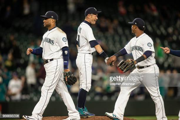 Ichiro Suzuki of the Seattle Mariners congratulates teammate including Robinson Cano and Jean Segura after a game against the Oakland Athletics at...