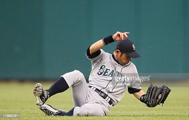 Ichiro Suzuki of the Seattle Mariners dives and makes the catch on the line drive off the bat of Austin Jackson of the Detroit Tigers in the fifth...
