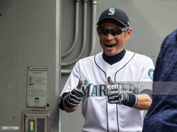 Ichiro Suzuki of the Seattle Mariners gives the thumbs up fro the dugout before a game against the Los Angeles Angels of Anaheim at Safeco Field on...