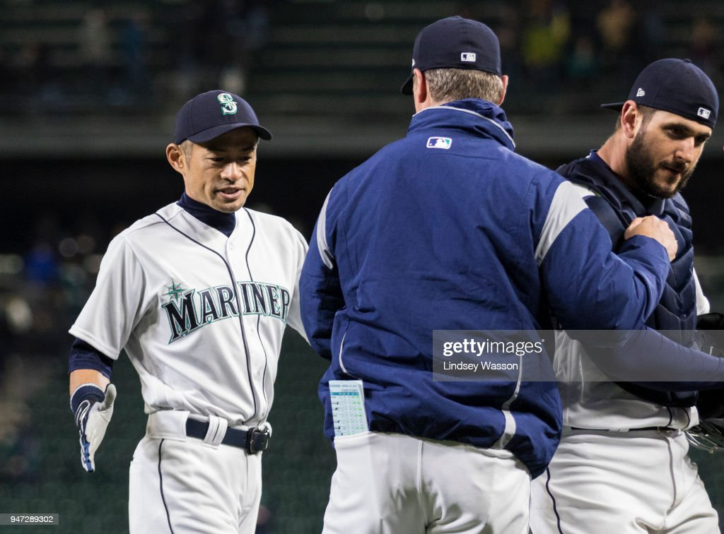 Ichiro Suzuki #51 of the Seattle Mariners greets Seattle Mariners manager Scott Servais along with David Freitas #36, right, after beating the Houston Astros at Safeco Field on April 16, 2018 in Seattle, Washington. The Seattle Mariners beat the Houston Astros 2-1.