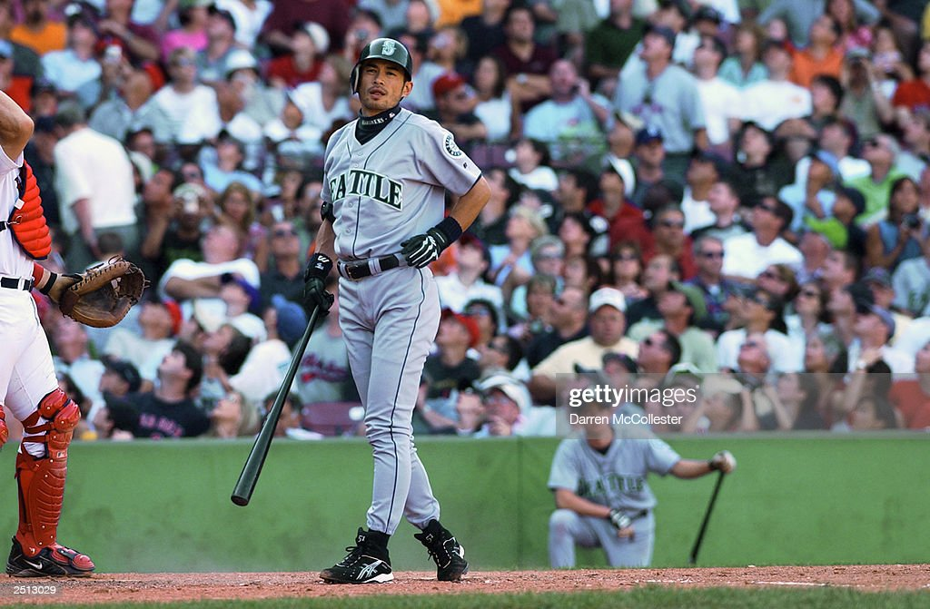 Ichiro Suzuki #51 of the Seattle Mariners grimaces after swinging and missing in his first appearance during the 9th inning of the MLB game against the Boston Red Sox on August 23, 2003 at Fenway Park in Boston, Massachusetts. The Red Sox won the game in the 10th inning, 7-6.