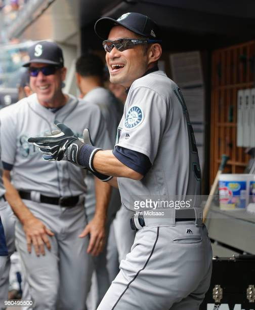Ichiro Suzuki of the Seattle Mariners has a laugh in the dugout before a game against the New York Yankees at Yankee Stadium on June 21 2018 in the...
