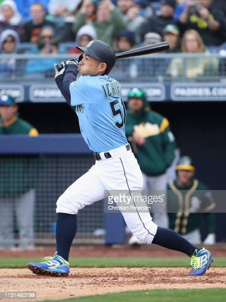 Ichiro Suzuki of the Seattle Mariners hits a RBI single against the Oakland Athletics during the third inning of the MLB spring training game at...