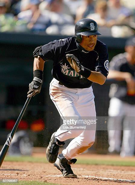 Ichiro Suzuki of the Seattle Mariners hits a single during a Spring Training game against the Milwaukee Brewers on March 7 2005 at Peoria Sports...