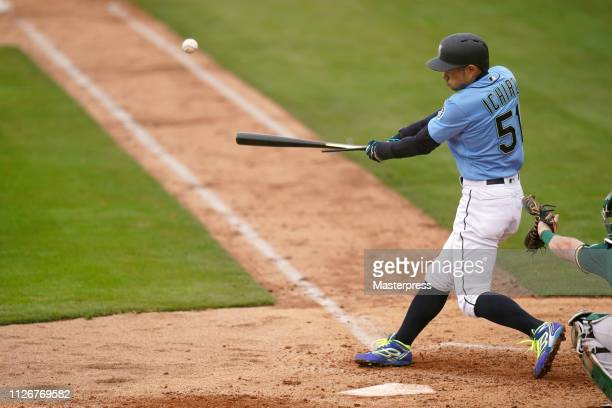 Ichiro Suzuki of the Seattle Mariners hits a single during the game between Seattle Mariners and Oakland Athletics on February 22 2019 in Peoria...