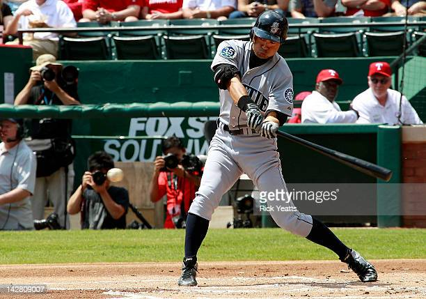 Ichiro Suzuki of the Seattle Mariners hits for a single in the first inning against the Texas Rangers at Rangers Ballpark in Arlington on April 12...