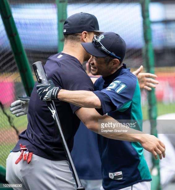 Ichiro Suzuki of the Seattle Mariners hugs Giancarlo Stanton of the New York Yankees before a a game at Safeco Field on September 8 2018 in Seattle...