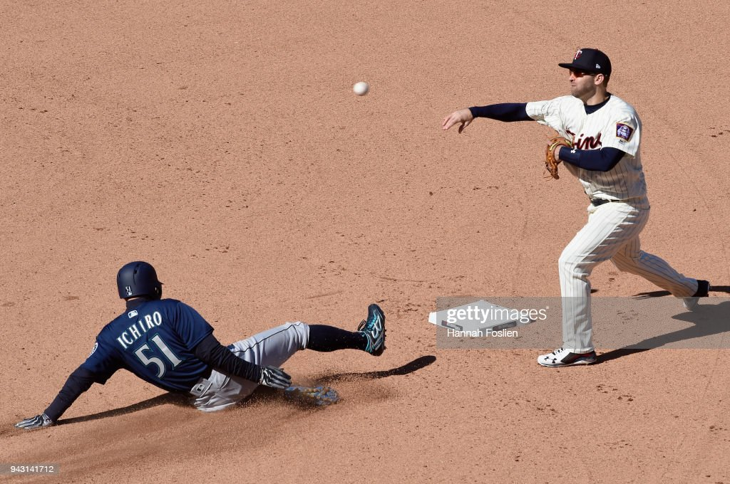 Ichiro Suzuki #51 of the Seattle Mariners is out at second base as Brian Dozier #2 of the Minnesota Twins tries to complete a double play during the seventh inning of the game on April 7, 2018 at Target Field in Minneapolis, Minnesota. The Mariners defeated the Twins 11-4.