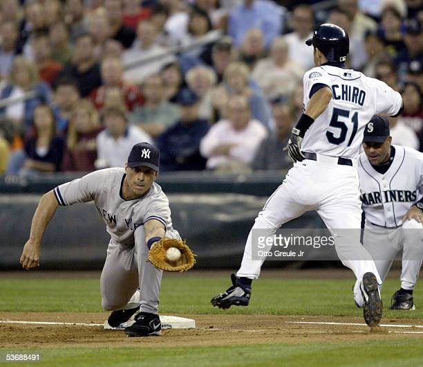Ichiro Suzuki of the Seattle Mariners is thrown out at first base on a strong throw from third baseman Alex Rodriguez as Tino Martinez of the New...