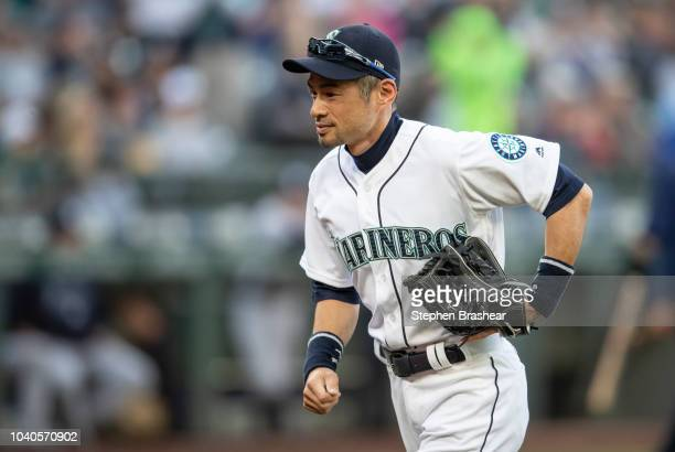 Ichiro Suzuki of the Seattle Mariners jogs off the field after the ceremonial first pitch before a game against the New York Yankees at Safeco Field...