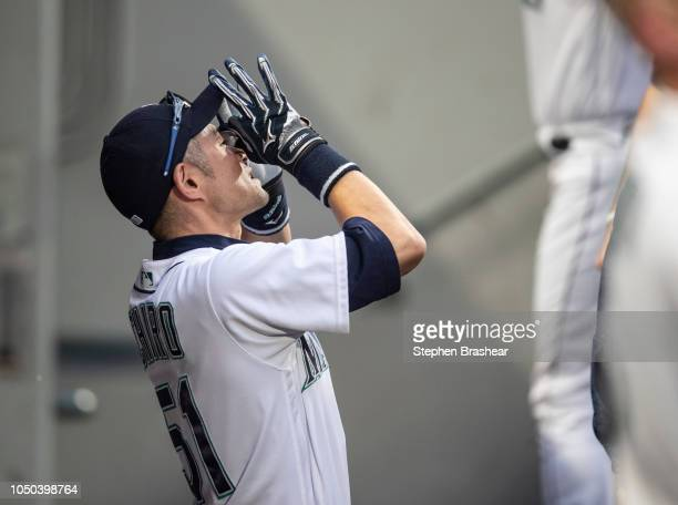 Ichiro Suzuki of the Seattle Mariners jokes aroudn in the dugout before a game against the Texas Rangers at Safeco Field on September 29 2018 in...