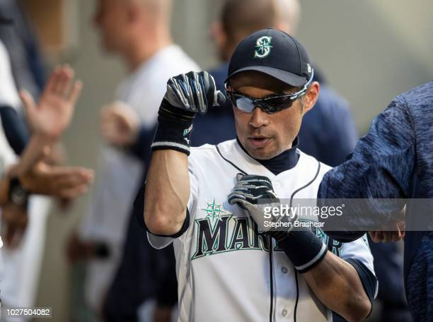 Ichiro Suzuki of the Seattle Mariners jokes around in the dugout before a game against the Baltimore Orioles at Safeco Field on September 5 2018 in...
