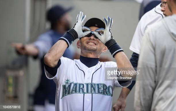Ichiro Suzuki of the Seattle Mariners jokes around in the dugout before a game against the New York Yankees at Safeco Field on September 8 2018 in...