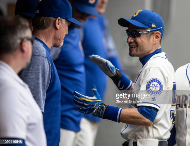 Ichiro Suzuki of the Seattle Mariners jokes around in the dugout before a game against the Texas Rangers at Safeco Field on September 30 2018 in...