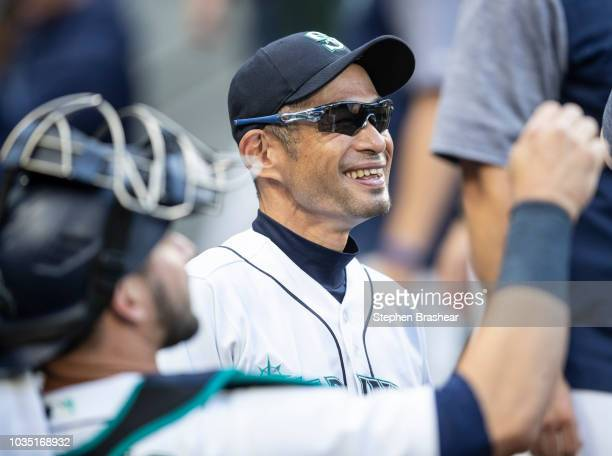Ichiro Suzuki of the Seattle Mariners jokes around in the dugout before game against the Baltimore Orioles at Safeco Field on September 5 2018 in...