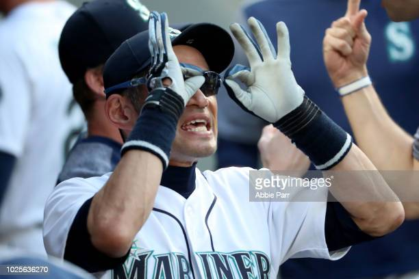 Ichiro Suzuki of the Seattle Mariners jokes around in the dugout prior to taking on the Los Angeles Dodgers during their game at Safeco Field on...