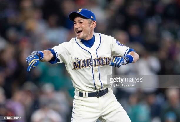 Ichiro Suzuki of the Seattle Mariners jokes around on the field after a game against the Texas Rangers at Safeco Field on September 30 2018 in...