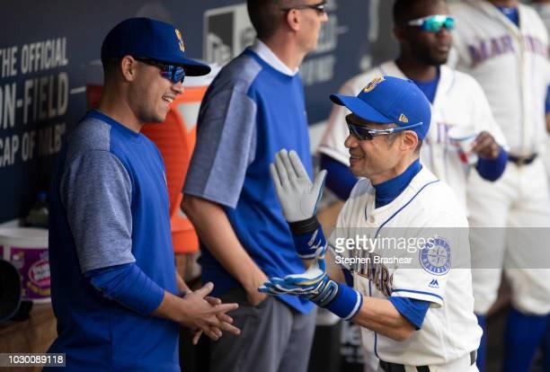 Ichiro Suzuki of the Seattle Mariners jokes around with Marco Gonzales of the Seattle Mariners before a game against the New York Yankees at Safeco...
