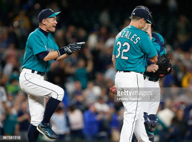 Ichiro Suzuki of the Seattle Mariners jokes with Marco Gonzales and Mike Zunino back after Gonzales pitched his first complete game against the...