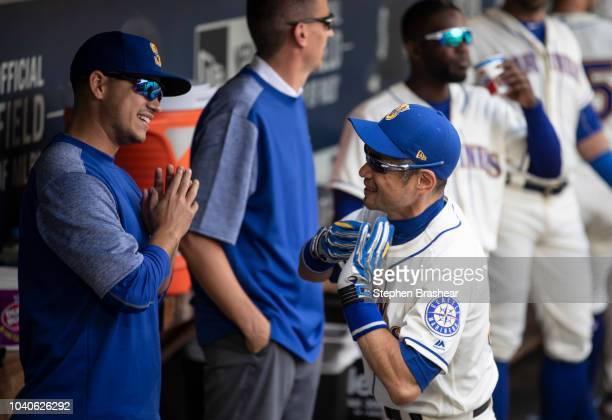 Ichiro Suzuki of the Seattle Mariners jokes with Marco Gonzales of the Seattle Mariners before a game against the New York Yankees at Safeco Field on...