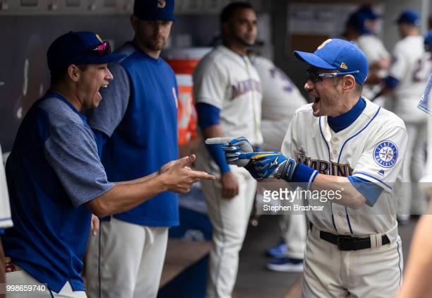 Ichiro Suzuki of the Seattle Mariners jokes with Marco Gonzales of the Seattle Mariners before a game against the Colorado Rockies at Safeco Field on...
